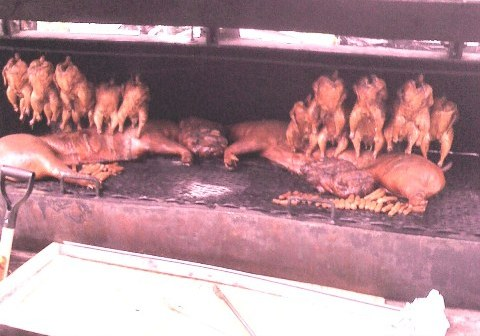 Whole Chickens and Half Pigs on Grill